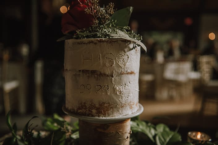 Grooms cake with wedding date and eucalyptus and burgundy rose accents