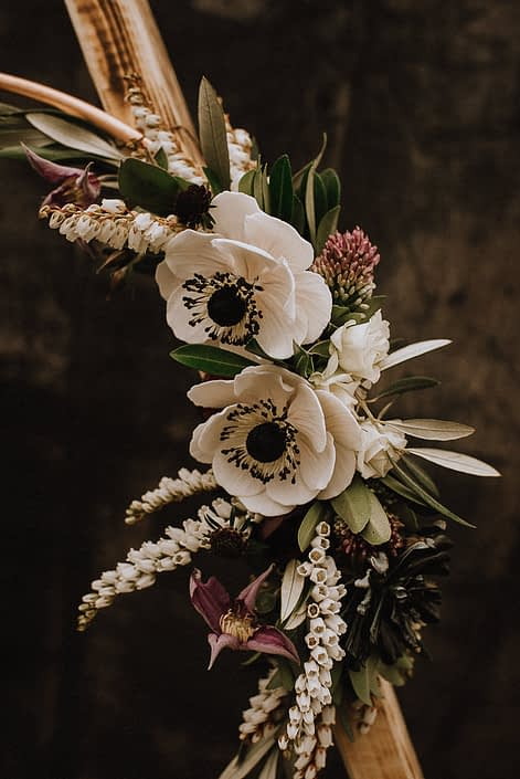 copper floral hoop with white anemone sugar flowers and pieris and purple clematis