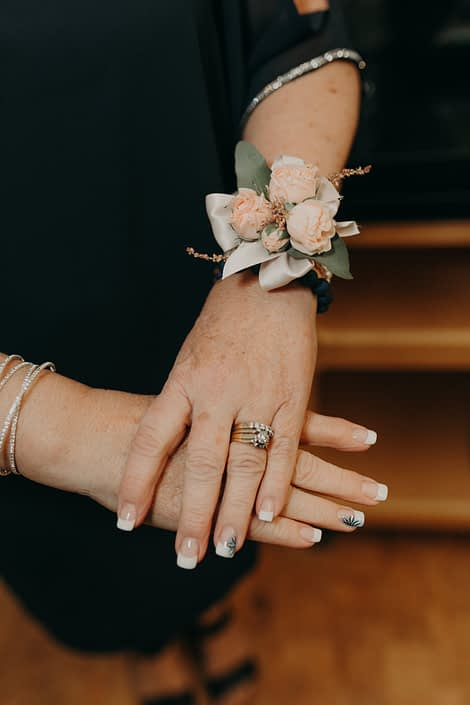 mother's wrist corsage with pink spray roses and pink astilbe