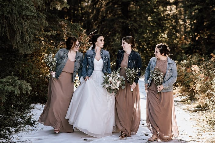 bride and bridesmaids in the winter with wax flower bouquets