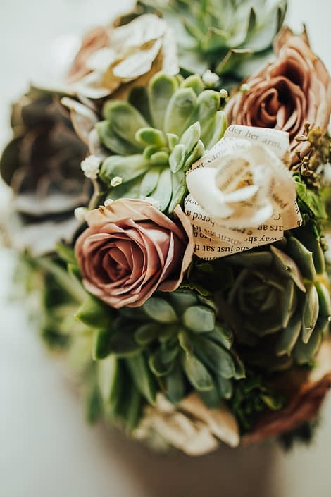 Close up photo of succulent and rose bouquet with paper flowers