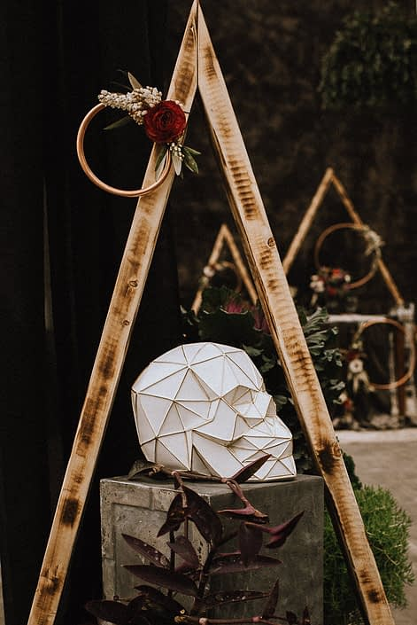 copper hoop with florals with red ranunculus and white pieris and geometric skull on box