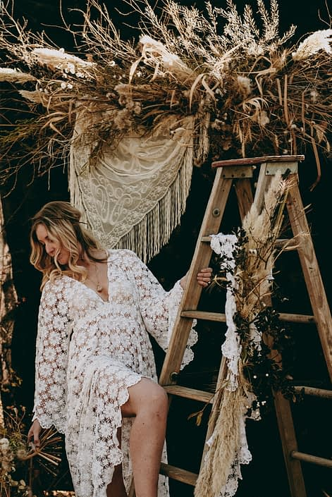blonde boho bride styled shoot with foraged backdrop if twig and pampas grass