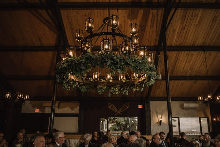 chandelier at Canyon skir resort decorated for a wedding with fresh mixed eucalyptus greenery garland