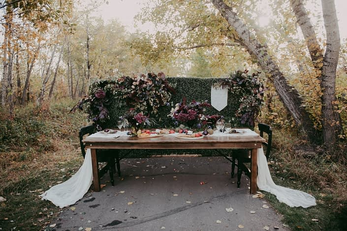 Mckenzie trails in Red Deer autumn harvest styled shoot with harvest table and chacuterie boards and burgundy floral accents
