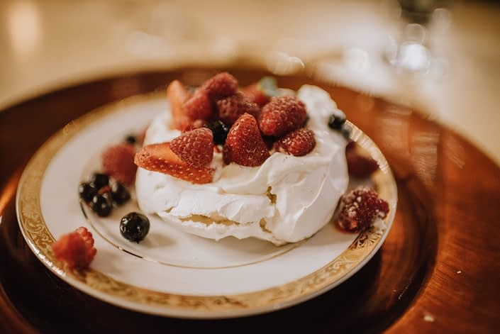 Delicious meringue dessert with strawberries and blueberries