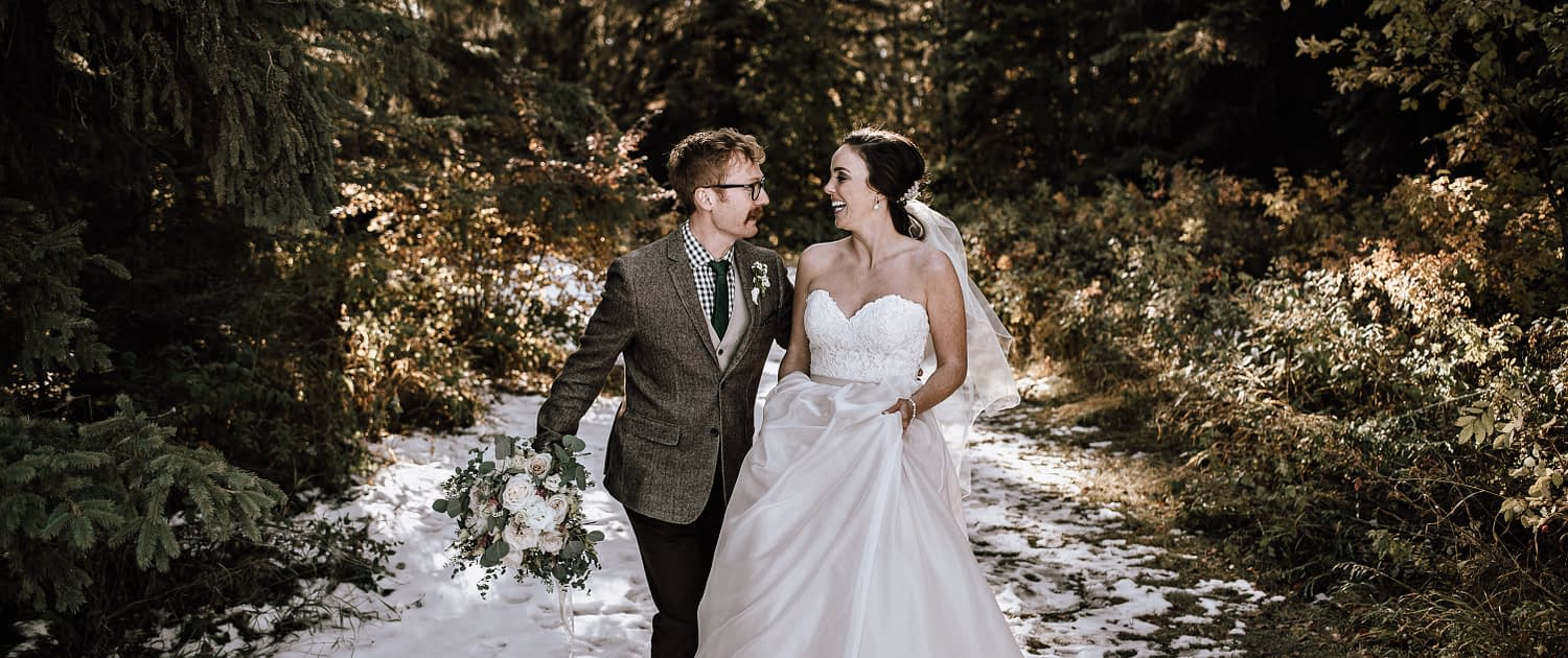 Bride and groom at a winter wedding with a white and blush bouquet and eucalyptus