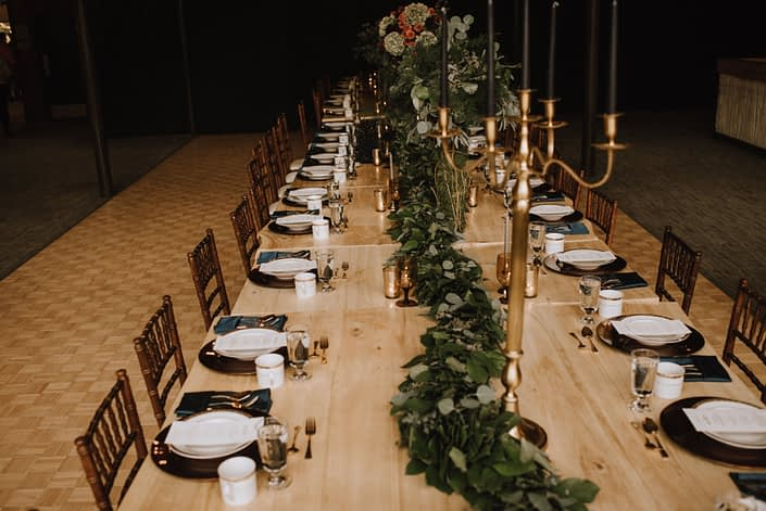 CalyxFloralDesrustic live edge table at the Canyon skir resort long table dinner with a fresh greenery garland running down the center of the tableignCanyonSkiResortElopement