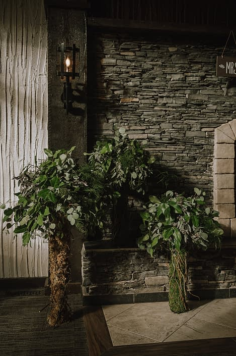 Fresh greenery floral design trees with moss and willow stems