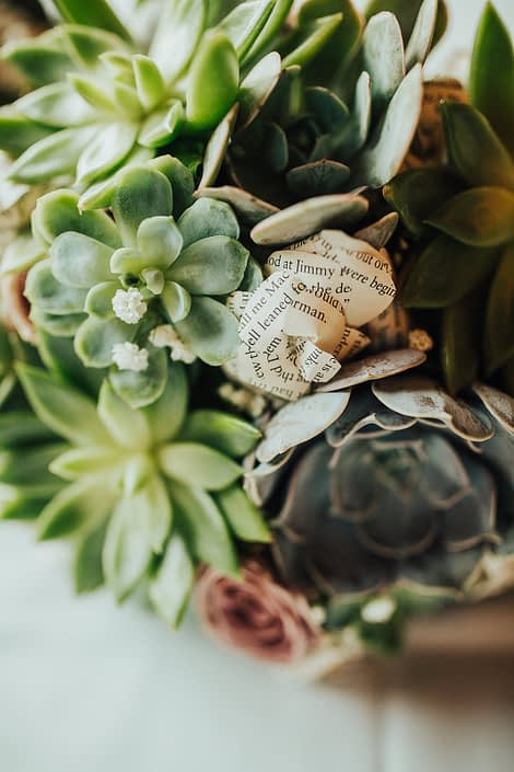 Close up photo of succulent bride bouquet with paper flowers and roses