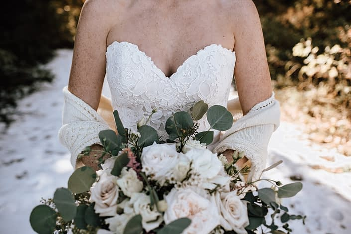 white bridal bouquet with roses garden roses and eucalyptus