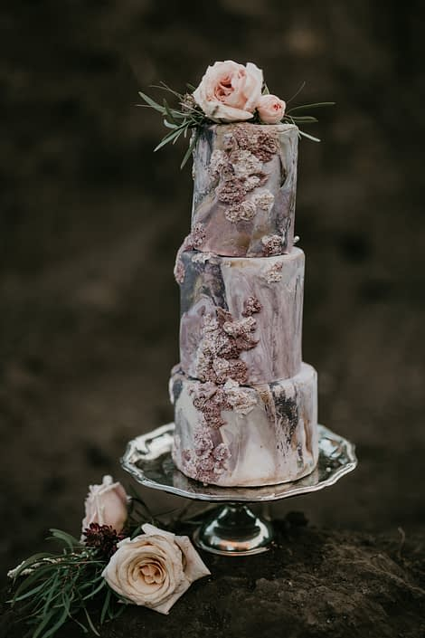 bas relief fondant cake in blush and mauve with quicksand roses and eucalyptus greenery to accent