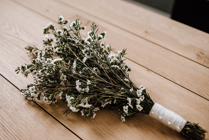 waxflower DIY bridesmaid bouquet with pearl pin and yarn handle