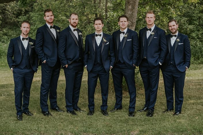 Groom and Groomsmen in navy Tuxedo with spray rose boutonnieres