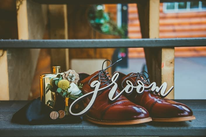 Groom's shoes, boutonniere, cologne