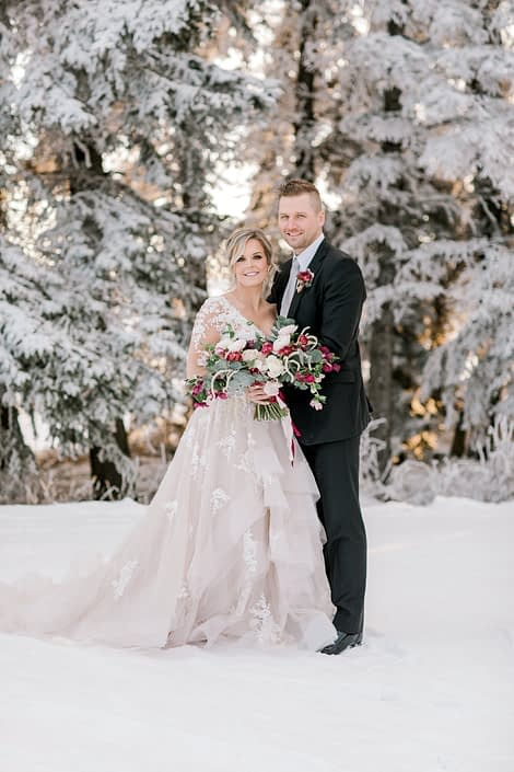 Blush and Burgundy Winter Photoshoot - bride and groom with bouquet and boutonniere