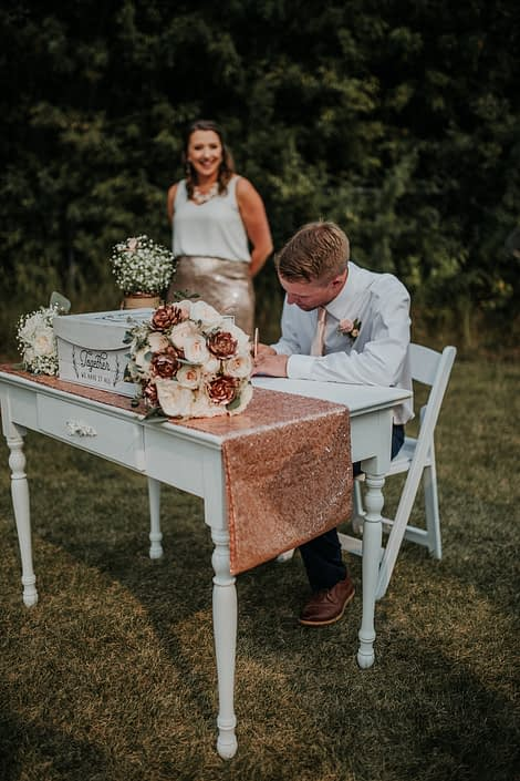 Singing table with bridesmaid and groomsman with bridal bouquet in rose gold ivory and blush with rose gold sequin table runner