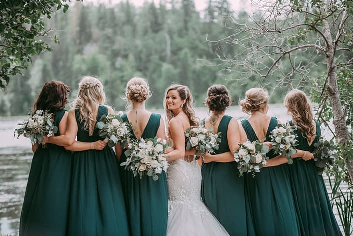 Natural white and green wedding; Bridesmaids wearing green dresses and bride with white and green bouquets