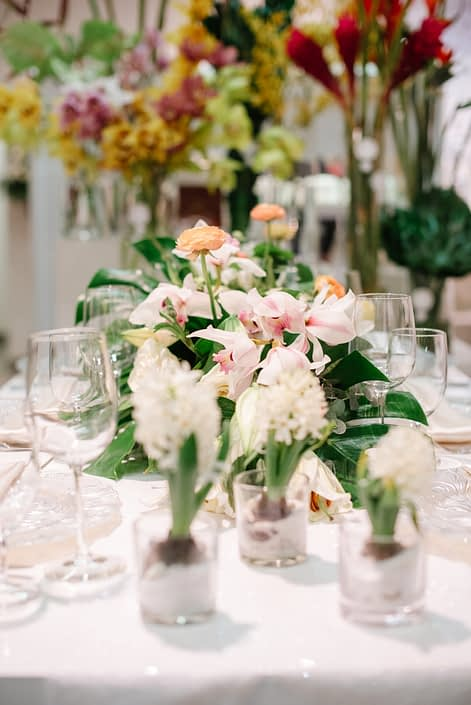 White hyacinth flowers and tropical cymbidium orchids in background of wedding table set up