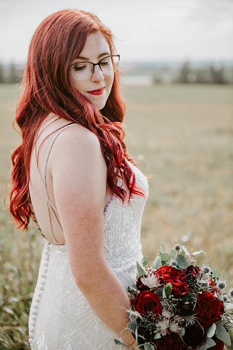 Hailey and Brandon's Burgundy and Royal Blue Wedding - Bride, Hailey, with burgundy and blue bridal bouquet