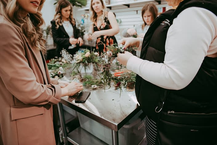 Workshop at Calyx Floral Design making floral crowns with fresh flowers and greenery