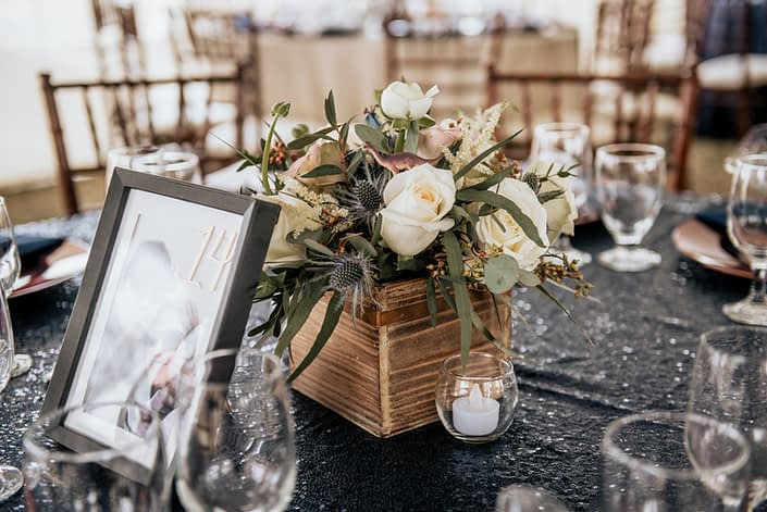 Mauve and Navy Centrepieces designed with white astilbe, eryngium, white o'hara garden roses, amnesia roses, playa blanca roses and eucalyptus in a wooden box