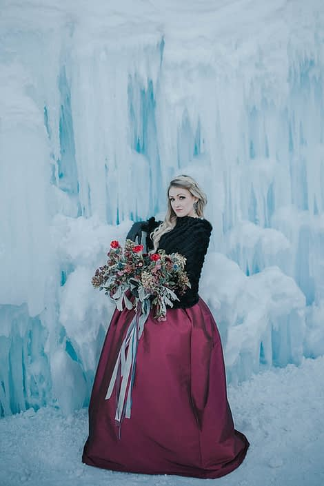 Engagement photos in winter at the edmonton ice castles with a loose and flowing organic bridal bouquet