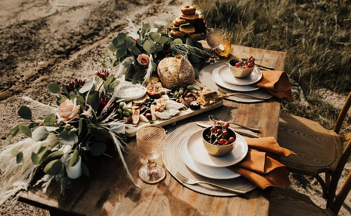 Boho sweetheart table with charcuterie and donuts