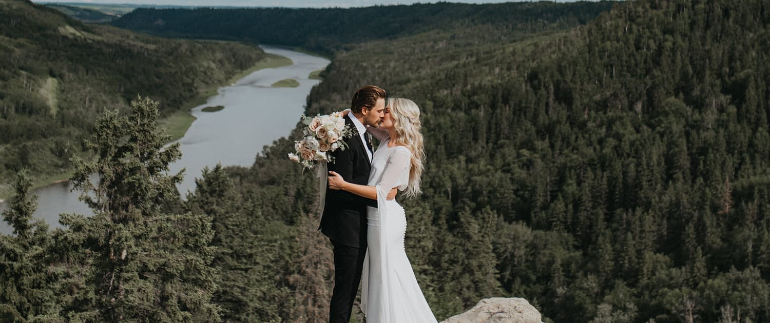 Bride and groom kissing in the Valley