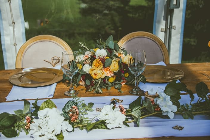 Head table with mustard yellow bridal bouquet.