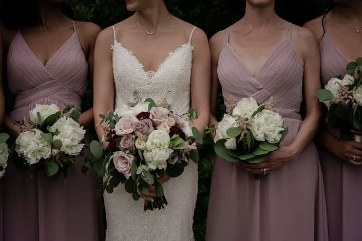 Bridal bouquet and bridesmaids bouquets; bridal bouquet featured burgundy dahlias, quicksand roses, white ranunculus, white peony, amnesia roses, pink astilbe and eucalyptus; bridesmaids bouquets designed with peonies and astilbe with eucalyptus.