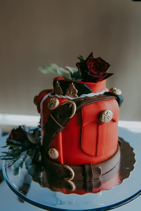 RCMP wedding cake with cake flowers such as eryngium and black baccara roses