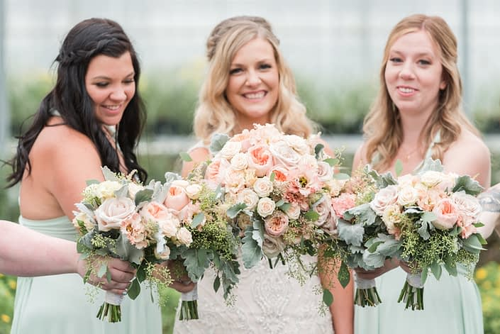 Megan and Steven's Rustic Pastel Wedding bouquets made of blush pink flowers including Juliet garden roses, apricot lisianthus, astilbe, quicksand roses, Jana spray roses, dusty miller and eucalyptus greenery.