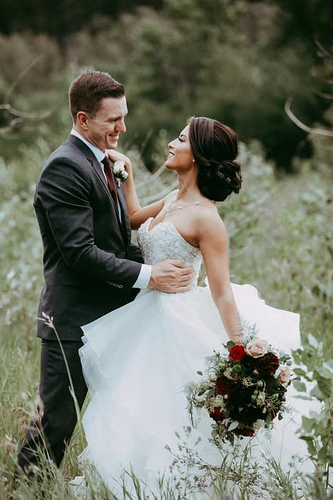 Bride and groom, Rikki Lee and Jake, with mauve and burgundy bridal bouquet