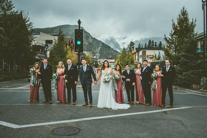 Meagan and Dwayne's bridal party on a street in Canmore, Alberta.