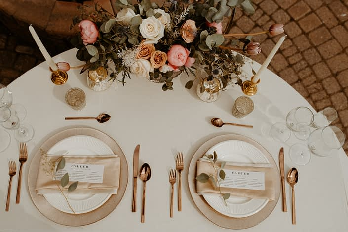 Overhead view of Emerald Lake Photoshoot 2020 sweetheart tablescape with floral arrangement featuring roses, peonies and tulips