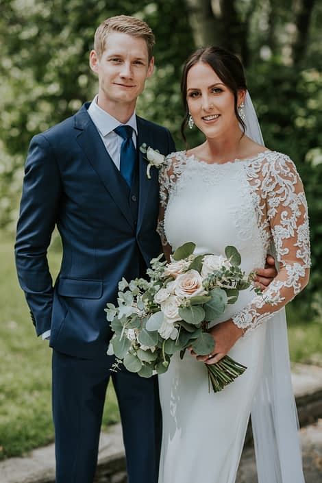 Brandi and Ryley with bridal bouquet in white, ivory and rusty rose tones; rusty rose wedding