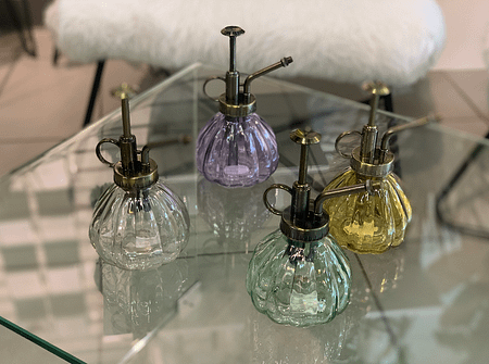 Vintage plant misters in amber, lavender, clear and sea glass green