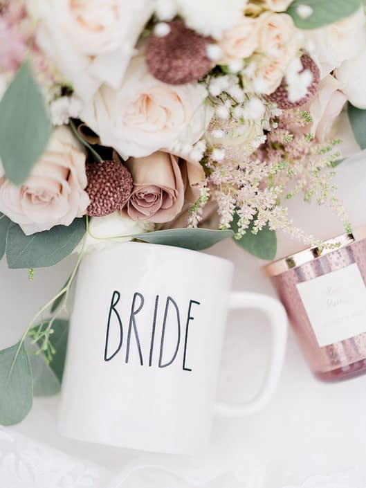 """Bride's dusty rose and blush bouquet with """"bride"""" mug and candle."""