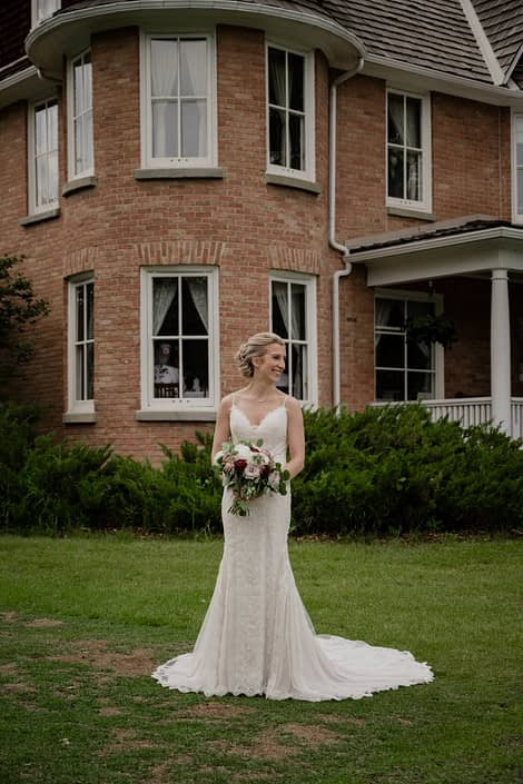 Burgundy and Mauve Central Alberta Wedding - Bride with burgundy and mauve bouquet at Cronquist house, Red Deer, Alberta.