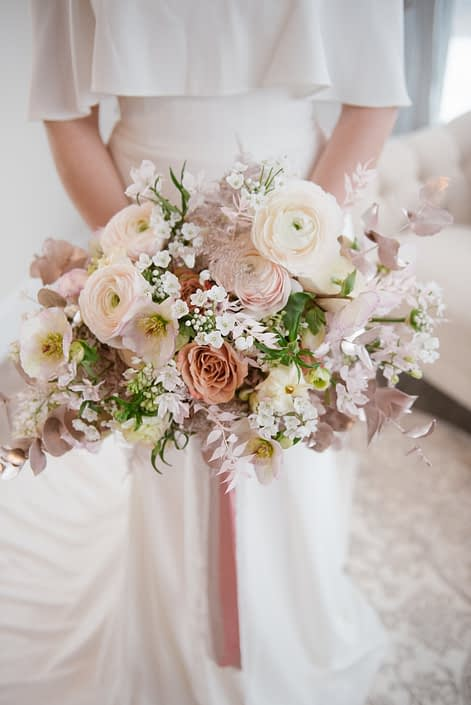 Blush pink, white and rose gold bridal bouquet; ranunculus, roses, hellebores, alyssum, cosmos, bleached italian ruscus, plumosa, rose gold painted eucalyptus