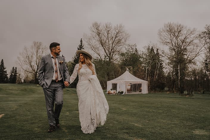 Modern boho couple with lace dress and hat