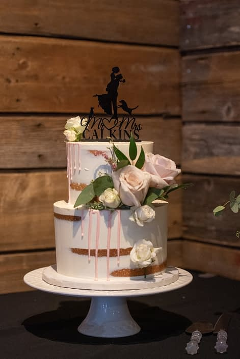 Naked cake decorated with pale pink quicksand roses, astilbe and seeded eucalyptus.