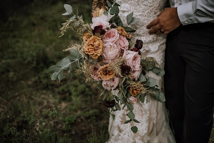 organic oblong shaped bridal bouquet designed with toffee roses, pale pink peony, pink ohara garden roses, gold plumosa and cinerea eucalytpus