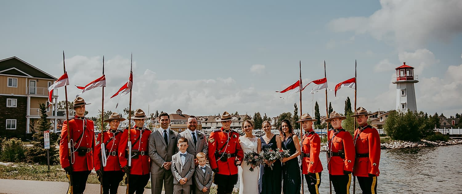Tanya and Sean's RCMP Wedding bridal party by the Sylvan Lake lighthouse