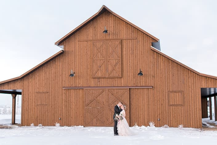Bride and groom in front of Sweet Haven Barn