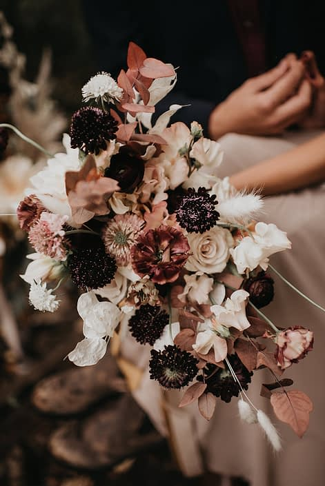 Down the Aisle fall styled shoot bouquet designed with plum, blush, white and orange colored flowers including scabiosa, roses, bunny tails, sweet peas, and fall foliage