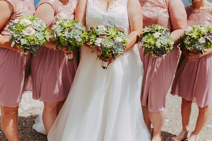 Bride and bridesmaids in blush with bridal boquuets designed with succulents, roses, echivaria and paper flowers