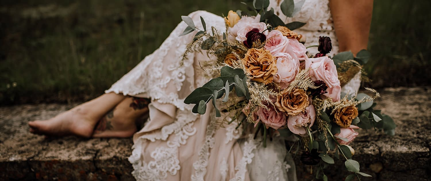 Bridal bouquet designed with toffee roses, pink ohara garden roses, gold plumos and cinerea eucalytpus