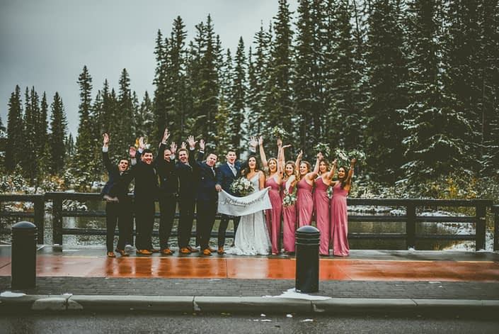 """Dwayne and Meagan's bridal party cheering with a """"Just Married"""" sign"""